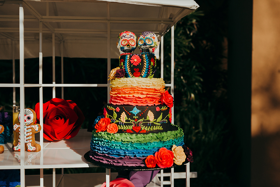 dia-de-los-muertos-shoot-cake-three-tiers-with-with-colorful-frosting-and-floral-embellishments