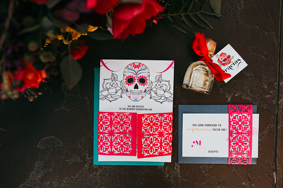 dia-de-los-muertos-shoot-invitaions-white-invites-with-bright-colorful-writing-and-text-and-sugar-skull-deatils