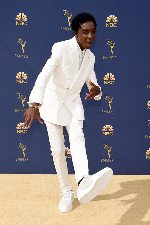 Caleb-McLaughlin-in-all-white-and-white-sneakers