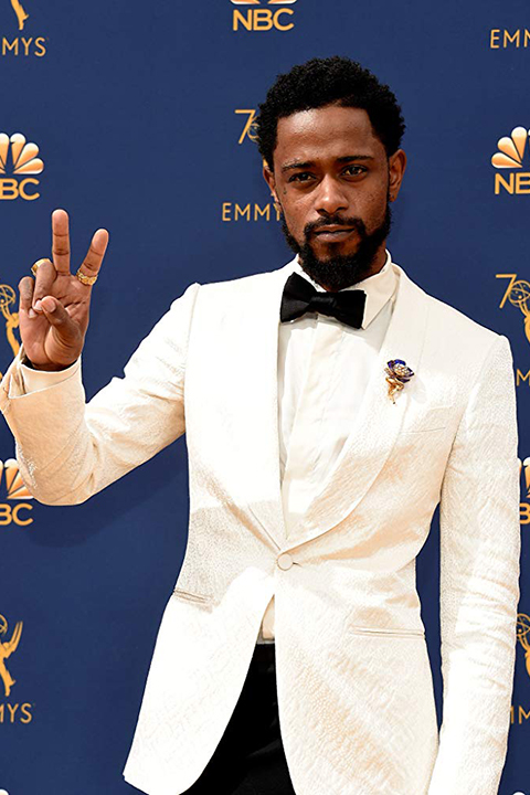 Lakeith-standfield-wears-a-traditional-white-jacket-with-black-pants-and-black-bow-tie