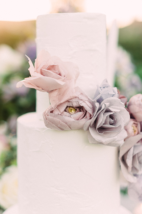 Inn-at-rancho-santa-fe-shoot-close-up-on-cake-white-two-tiered-cake-with-lavander-sugar-flowers