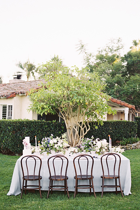 Inn-at-rancho-santa-fe-shoot-table-set-up-distance-shot-white-table-linens-with-brown-chairs