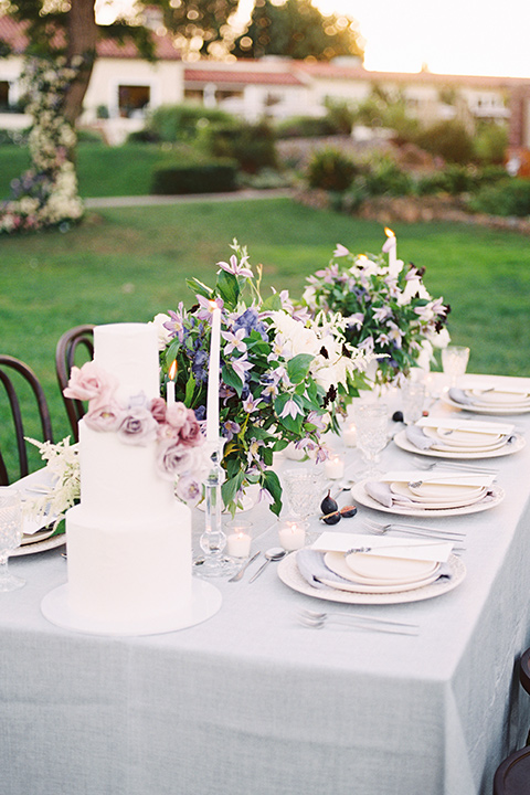 Inn-at-rancho-santa-fe-shoot-table-set-up-to-the-side-white-table-linens-with-gold-chairs-and-metallic-acents