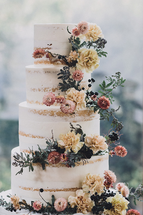 amanda-and-codys-wedding-at-the-1909-cake-four-tiers-with-natural-frosting-with-florals-cascading-down