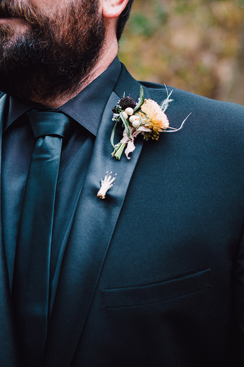 amanda-and-codys-wedding-at-the-1909-close-up-on-groom-groom-in-all-black-shawl-lapel-tuxedo-and-a-small-hand-pin-on-the-lapel