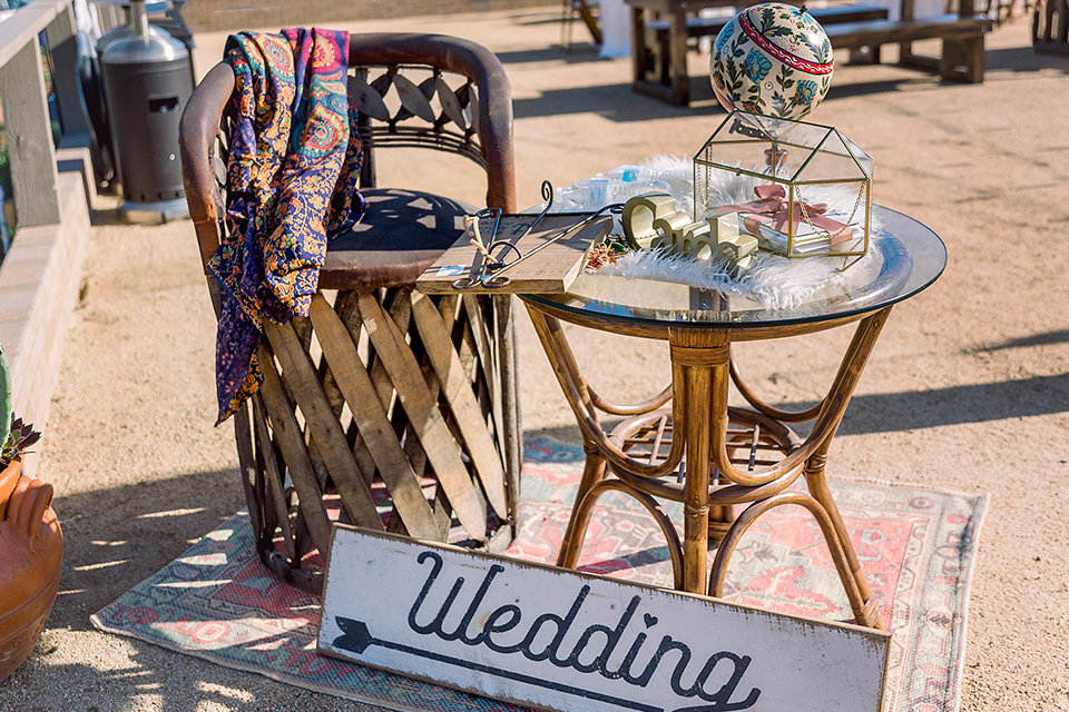 Emerald-peak-shoot-boho-chair-and-wedding-sign-wooden-chairs-and-tables-that-go-with-the-boho-vibes