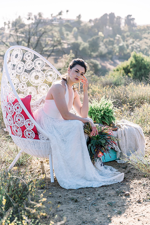Emerald-peak-shoot-bride-in-chair-bride-in-a-bohemian-style-lace-dress-off-the-shoulder