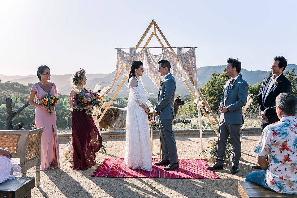 Emerald-peak-shoot-ceremony-set-up-bride-in-a-bohemian-style-lace-dress-off-the-shoulder-groom-in-a-charcoal-grey-suit-with-a-tan-vest-grooms-men-in-charcoal-suits-and-bridesmaids-in-alternating-colorful-dresses