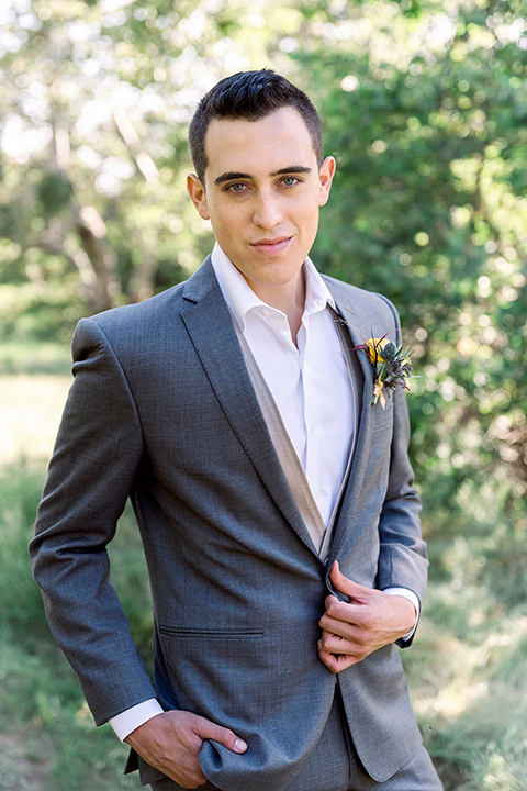 Emerald-peak-shoot-groom-facing-camera-in-a-charcoal-grey-suit-with-a-tan-vest