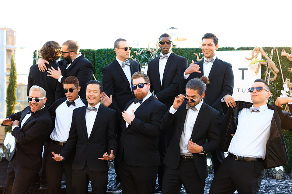 evolution-of-style-party-group-of-guys-in-black-tuxedos-a-bunch-of-guys-in-black-tuxedos-making-a-funny-face-and-posing-at-the-fifth-restaurant