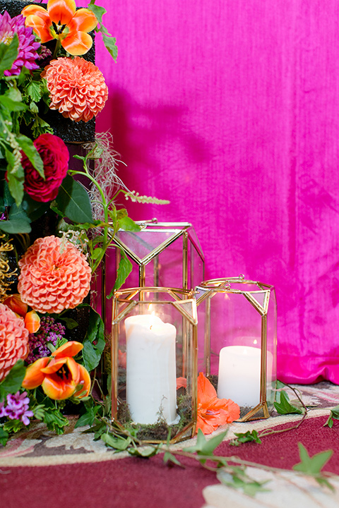Exquisite-weddings-magazine-candle-and-floral-décor-hot-pink-table-linen-with-orange-and-green-florals-and-white-candles