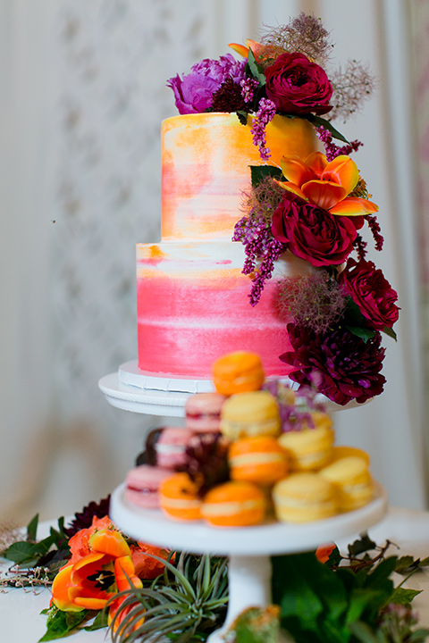 Exquisite-weddings-magazine-colorful-cake-three-tier-cake-with-bright-colored-fondant-and-florals-cascading-down
