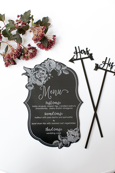 Exquisite-weddings-magazine-menus-black-menu-cards-with-white-calligraphy-and-his-and-hers-drink-stir-sticks
