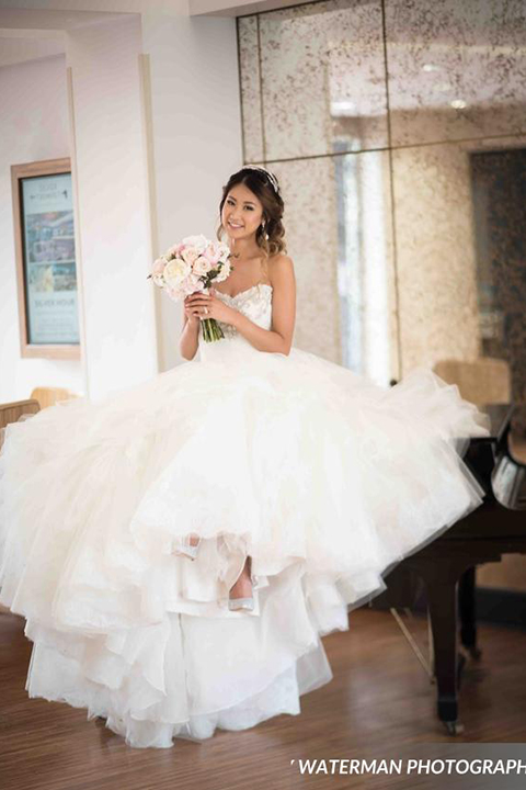 Classic glamour wedding shoot at the avenue of the arts hotel bride strapless ball gown with beaded detail on top with sweetheart neckline holding white and pink floral bridal bouquet