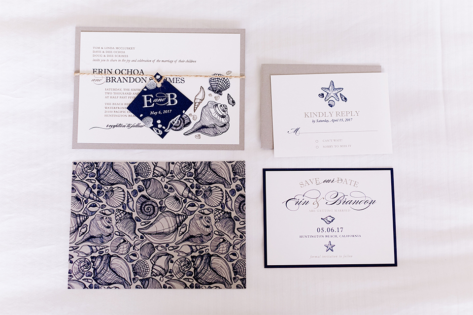 Huntington beach wedding at the hilton waterfront resort wedding invitations white with blue writing and patterned designs with white background and tan envelopes wedding photo idea for invitations