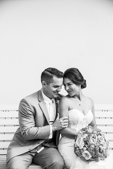 skybox-venue-wedding-bride-and-groom-black-and-white-photo-bride-in-strapless-gown-with-beaded-bodice-groom-in-light-grey-suit-with-ivory-tie