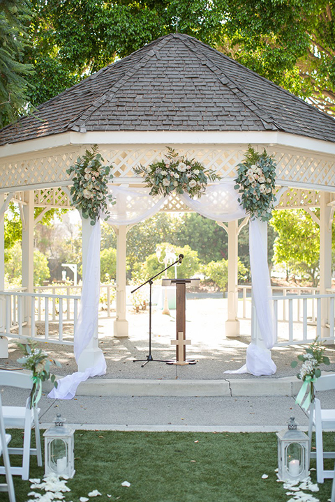 Orange county outdoor summer wedding at the heritage museum ceremony set up with white gazebo and white chiffon decor and greenery florals wedding photo idea for ceremony set up