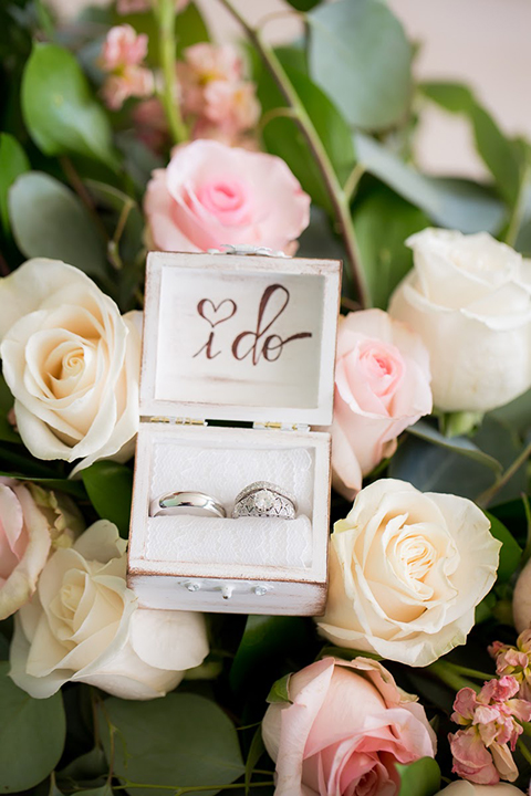 Orange county outdoor summer wedding at the heritage museum white and blush pink flowers background for wedding rings in white box with black calligraphy writing that says i do wedding photo idea for rings