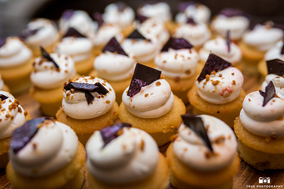 San diego outdoor wedding at leo carillo ranch reception table set up with dessert table and smores cupcakes with flower decor wedding photo idea for dessert table