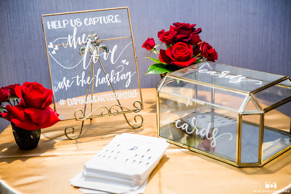 San diego glamorous wedding at the us grant hotel wedding reception decor glass sign with gold trim and white calligraphy writing for sign and card box with red flower decor wedding photo idea