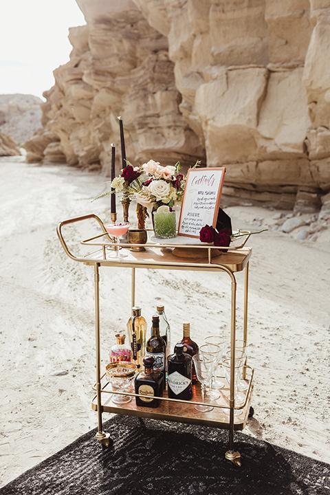 Anza-Borrego-styled-shoot-bar-cart-gold-bar-cart-with-reception-decor