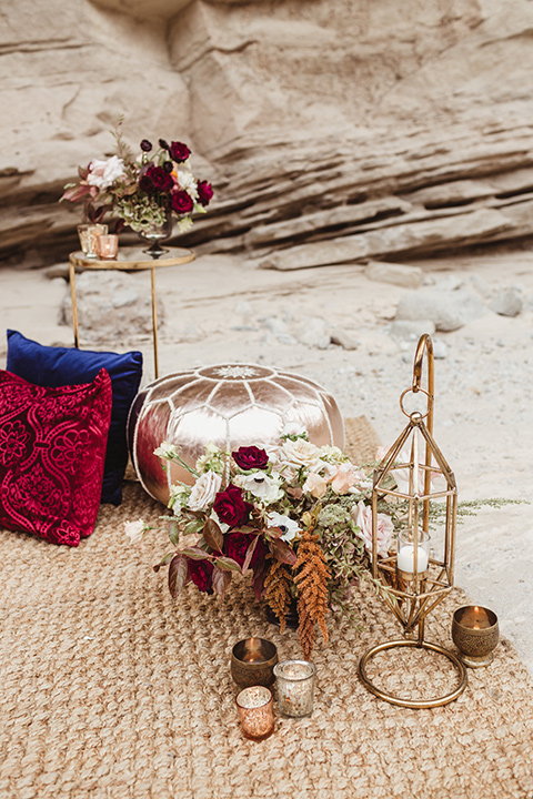 Anza-Borrego-styled-shoot-ground-decor-pillows-and-gold-candle-holders