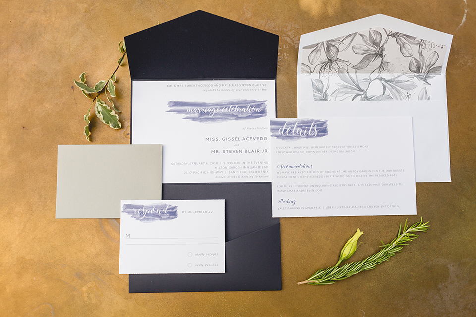 San diego wedding at the hilton bayside white and navy wedding invitations with blue writing on gold background with flower decor wedding photo idea for invitations
