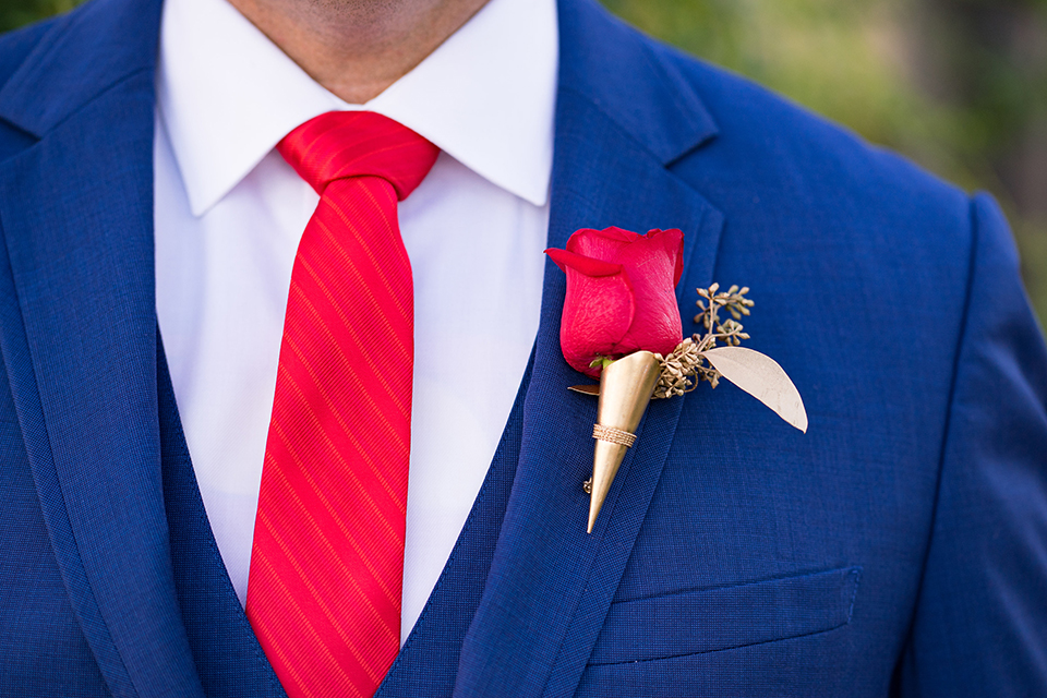 Boutonniere-style-cobalt-blue-notch-lapel-suit-with-a-red-long-tie-and-matching-red-floral-boutonniere