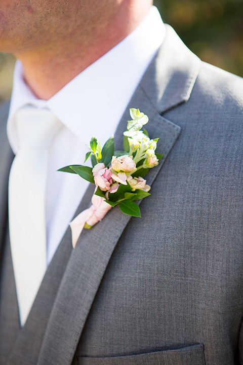 Boutonniere-style-grey-notch-lapel-suit-with-a-white-long-tie-and-a-white-simple-floral-boutonniere