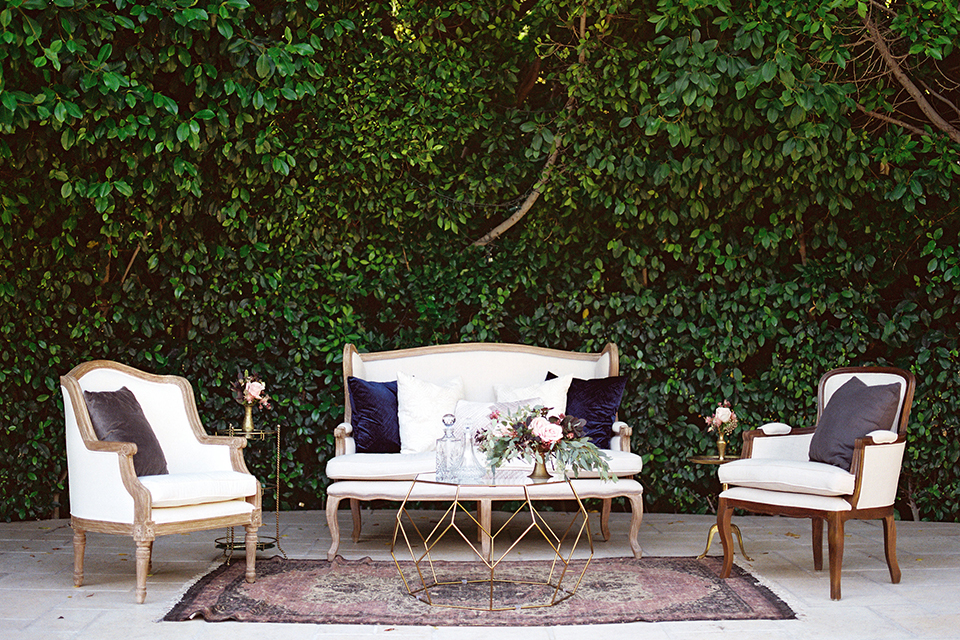 Los angeles outdoor wedding at eden gardens reception lounge decor white vintage couch with matching chairs and white table with green and pink flower decor