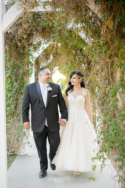 Orange county outdoor summer wedding at the heritage museum bride ball gown with lace straps and a sweetheart neckline with a short tulle skirt and long veil with groom black shawl lapel tuxedo with a white dress shirt and white vest with a white tie and white floral boutonniere