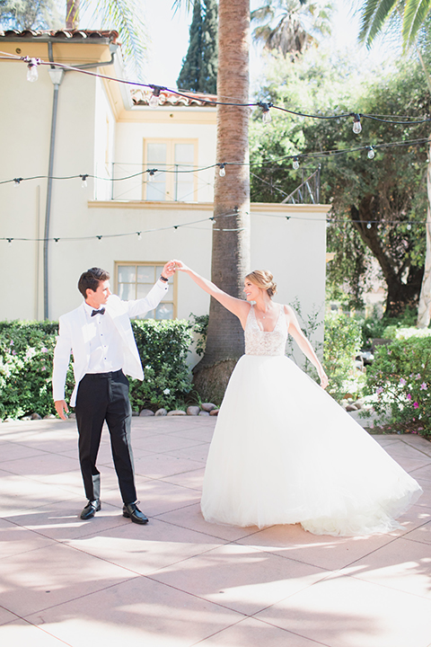 Pasadena outdoor wedding at the maxwell house bride mermaid style gown with thin spaghetti straps and beaded detail with a sweetheart neckline and groom white dinner jacket with black tuxedo pants and a white dress shirt with a black bow tie dancing