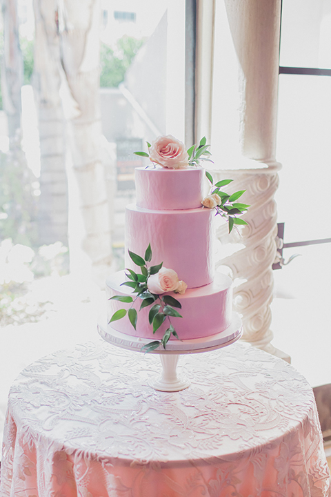 Pasadena outdoor wedding at the maxwell house dessert table set up with wedding cake and wedding cake sign glass sign with calligraphy writing on gold tray for wedding cake three tier pink wedding cake with flower and greenery decor on top and on sides wedding photo idea