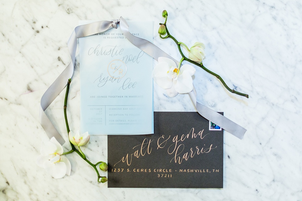 Southern california outdoor wedding at diamond bar golf course wedding invitations light blue invitations with calligraphy writing and dark blue invitations with calligraphy and white and green flower decor on white and grey marble background wedding photo idea