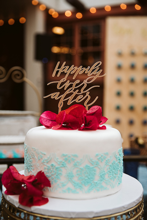 Adobe-de-Capastrano-Amanda-and-Asher-cake-white-and-light-blue-cake-with-bougainvillea-florals-as-accents-and-a-gold-happily-ever-after-sign