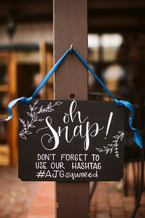 Adobe-de-Capastrano-Amanda-and-Asher-reception-décor-with-a-sign-to-remind-people-to-tag-the-bride-and-groom-in-any-wedding-photos-the-guests-may-take-it-is-a-sign-that-says-oh-snap