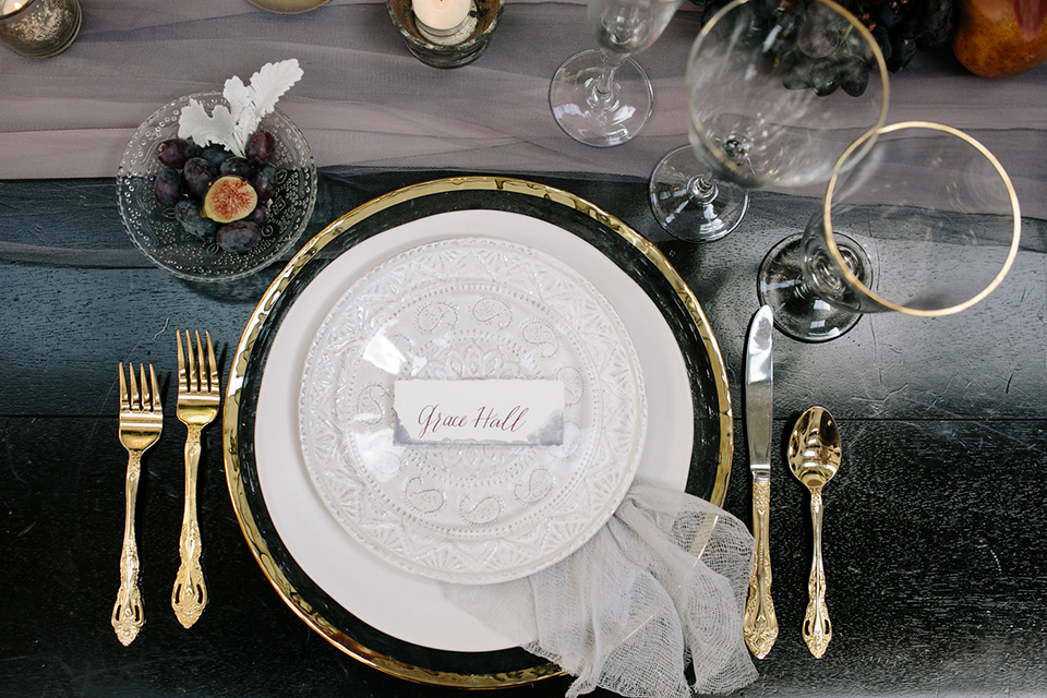 Southern-california-wedding-at-the-ebell-of-long-beach-table-set-up-with-place-setting-white-tableware-gold-silverware-clear-crystal-glasses