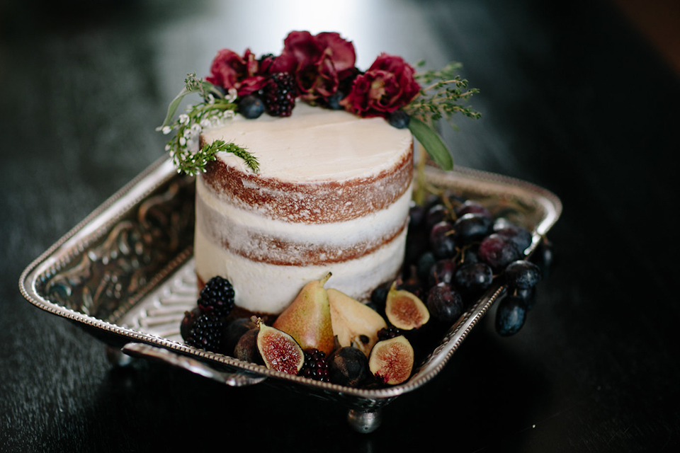 Southern-california-wedding-at-the-ebell-of-long-beach-wedding-cake-small-two-tiered-cake-with-simple-design-of-figs-and-flowers-as-decor