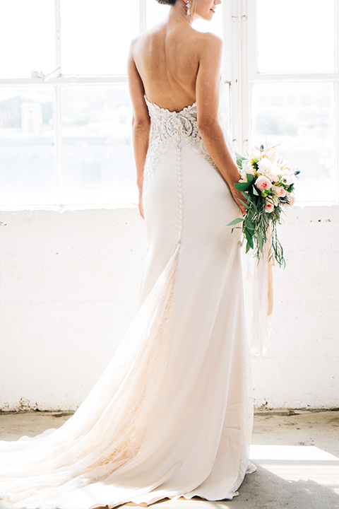FD-Studios-bridal-gown-from-behind-bride-wearing-a-flowing-strapless-gown-with-a-lace-bodice