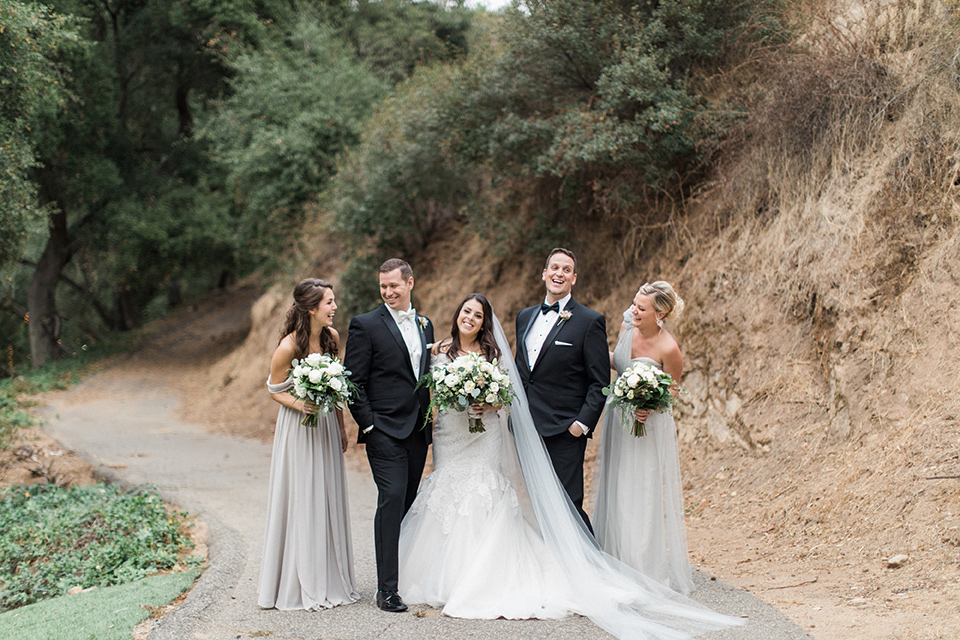 los-willows-wedding-bridal-party-bride-in-a-tulle-ballgown-with-sleeves-groom-in-a-traditional-black-tuxedo-with-black-bow-tie-and-tuxed-shoes