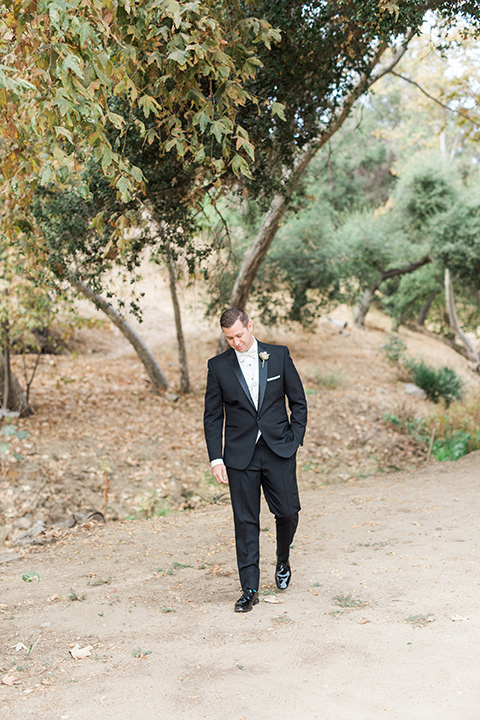 los-willows-wedding-groom-walking-in-a-traditional-black-tuxedo-with-black-bow-tie-and-tuxed-shoes