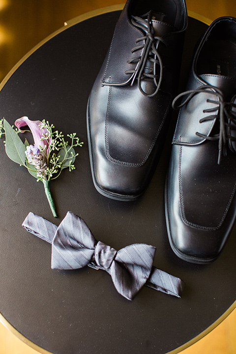 Avenue-of-the-arts-wedding-men-accessories-groom-inblack-tuxedo-with-a-silver-vest-and-silver-bowtie