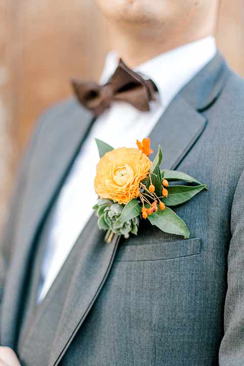 estate-on-second-shoot-close-up-on-groom-accessories-groom-in-a-charcoal-grey-tuxedo-with-a-dark-brown-bow-and-shoes