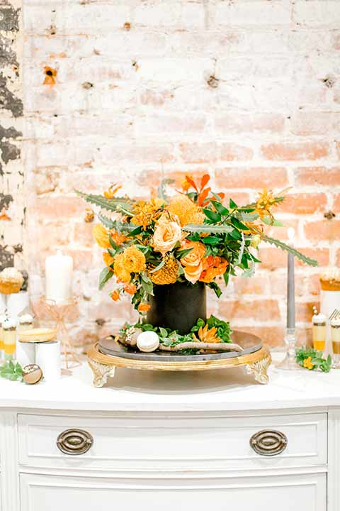 estate-on-second-shoot-florals-on-white-table-orange-and-cream-florals