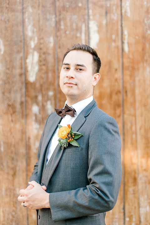 estate-on-second-shoot-groom-style-groom-accessories-groom-in-a-charcoal-grey-tuxedo-with-a-dark-brown-bow-and-shoes