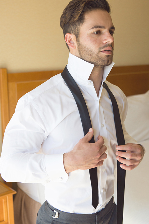 Groom-in-charcoal-tuxedo-and-a-long-black-tie