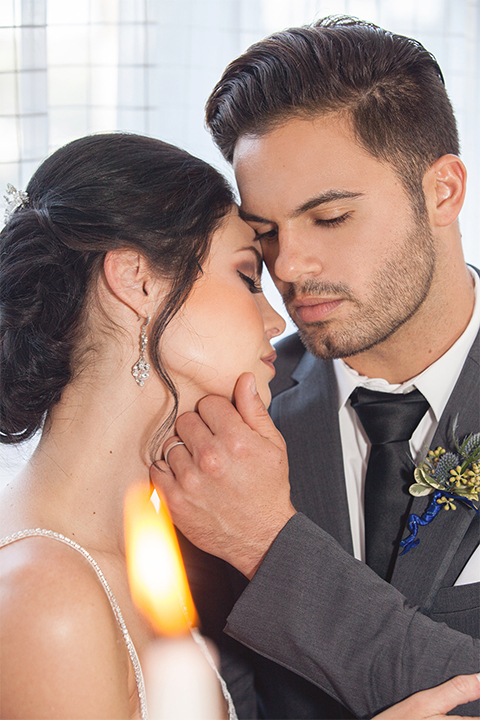 Grand-Pacific-Palisades-Groom-in-charcoal-tuxedo-with-a-long-black-tie-bride-in-a-lace-dress-with-straps