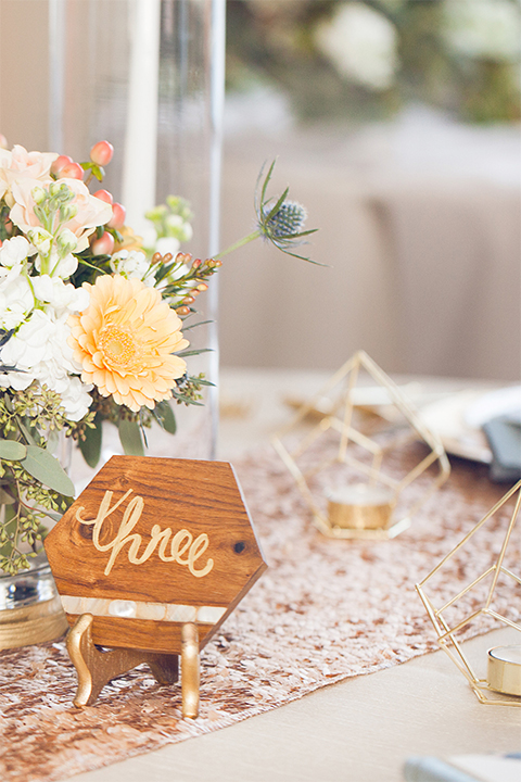 Grand-Pacific-Palisades-small-wooden-table-décor-with-calligraphy