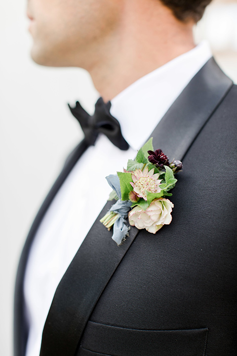 hammersky-editorial-shoot-close-up-on-groom-groom-in-a-black-shawl-lapel-tuxedo-with-black-bow