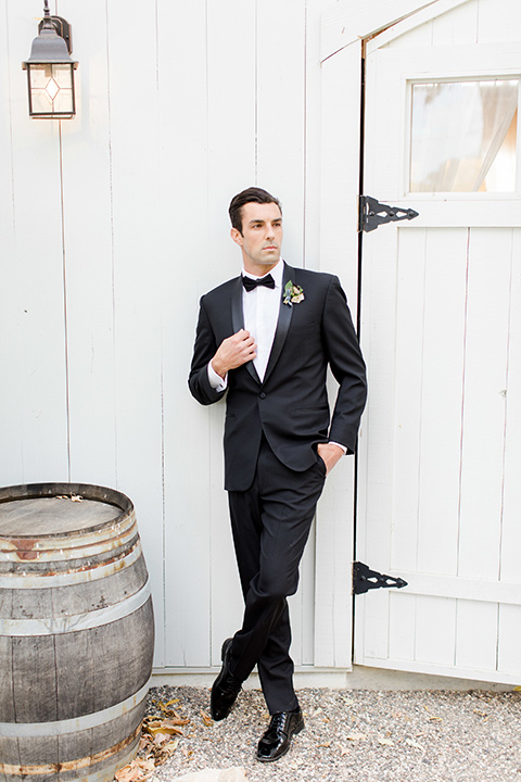 hammersky-editorial-shoot-groom-groom-in-a-black-shawl-lapel-tuxedo-with-black-bow